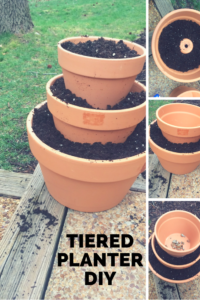 Make a tiered planter out of terra cotta pots.