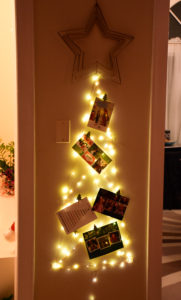Christmas card display made from cool-touch LED lights and Command hooks.