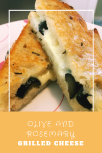 This olive and rosemary grilled cheese combines tradiitional Mediterranean flavors in a gooey grilled cheese. Grilled cheese grows up!